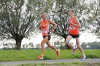 ATLETIEK: SNEEK: 30-08-2014, 20 km. Sneek-Bolsward-Sneek, Winnaar Jan Venhuizen, Riekele Kobes, ©foto Martin de Jong