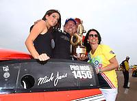 Apr 27, 2014; Baytown, TX, USA; NHRA pro mod driver Mike Janis celebrates after winning the Spring Nationals at Royal Purple Raceway. Mandatory Credit: Mark J. Rebilas-