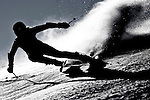 A skier is silhouetted during a race