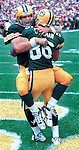Green Bay Quarterback Brett Favre celebrates with Antonio Freeman, after Freeman caught a 84-yard td pass in the fourth quarter. WSJ/Apps.