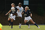 30 August 2009: North Carolina's Nikki Washington (26) is defended by Greensboro's Heather Mitrisin (22) and Tabitha Padgett (right). The University of North Carolina Tar Heels defeated the University of North Carolina Greensboro Spartans 1-0 at Fetzer Field in Chapel Hill, North Carolina in an NCAA Division I Women's college soccer game.