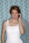 Bridezilla yelling into her cell phone.