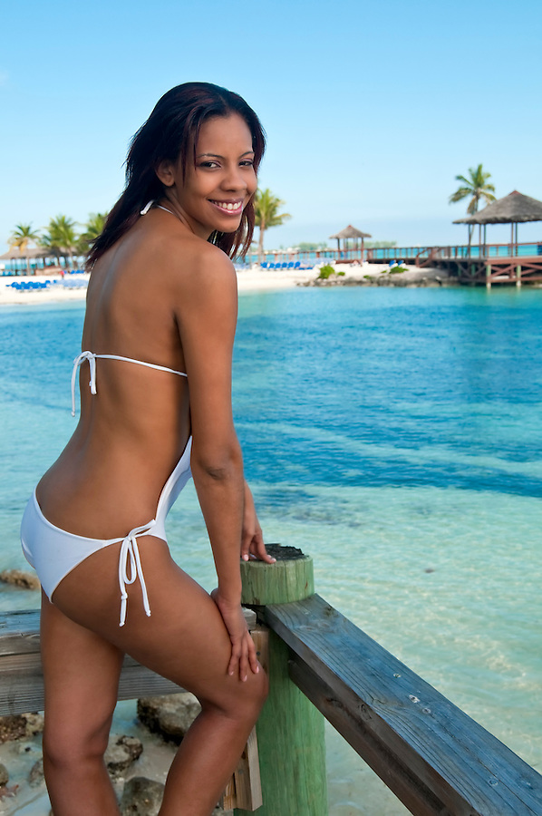 Young bahamian woman enjoys the beach in the caribbean.
