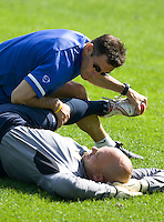 USA's Dave Andrews stretches Marcus Hahnemann during practice in Hamburg, Germany, for the 2006 World Cup, June, 9, 2006.
