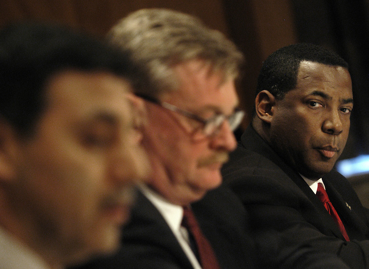 """Warren Riley (R), superintendent of police, New Orleans Police Department, watches Michael Vanacore, director of international affairs, U.S. Immigration and Customs Enforcement, Homeland Security Department; and Kenneth Kaiser, special agent in charge, Boston Field Office, FBI,  testify at a Senate Homeland Security and Governmental Affairs Committee hearing on """"Hurricane Katrina: Managing Law Enforcement and Communications in a Catastrophe.""""."""