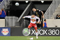 Danny Califf (4) of the Philadelphia Union heads the ball over Connor Chinn (25) of the New York Red Bulls during a US Open Cup qualifier at Red Bull Arena in Harrison, NJ, on April 27, 2010.