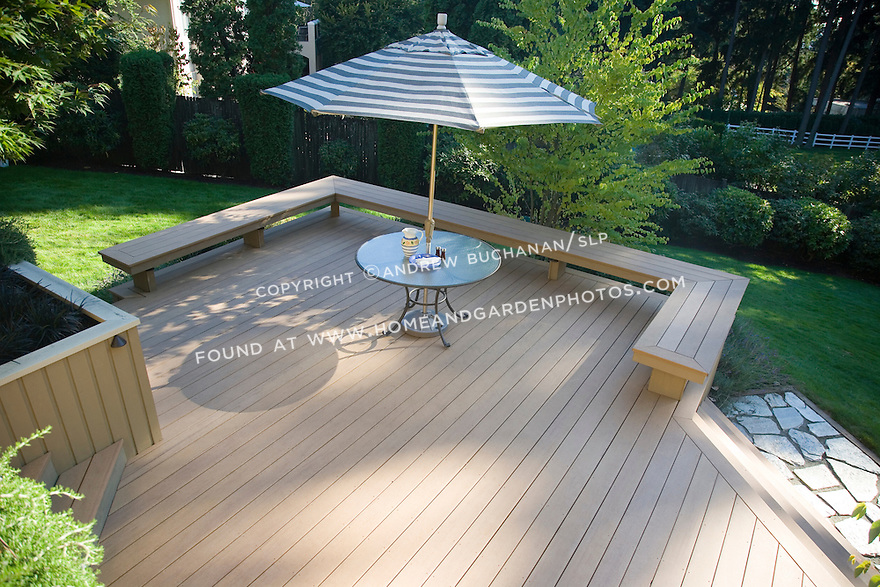 A sunny summer scene of a raised multi level residential for Composite decking brands