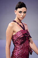 Model walks runway in an outfit by Walid Atallah, from the Walid Atallah Spring Summer 2012 collection, during Couture Fashion Week Spring 2012.