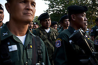 Thai border police look on as Burmese refugees begin to return home after less than three days in Thailand. An estimated 20,000 had fled into Thailand to escape clashes in the border towns of Myawaddy and Pyaduangsu, only a day after a Burmese election which critics described as a sham..Ethnic minorities along the Thai-Burma border had warned earlier that the junta would launch a major offensive after the election, as many armed rebel groups had refused to become part of the government-controlled Border Guard Forces.&nbsp;