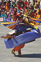 "A monk perfoms during annual Thimpu Tshechu. The Tshechu is a festival honouring Guru Padmasambhava, ""one who was born from a lotus flower."" This Indian saint contributed enormously to the diffusion of Tantric Buddhism in the Himalayan regions of Tibet, Nepal, Bhutan etc. around 800 AD. He is the founder of the Nyingmapa, the ""old school"" of Lamaism which still has numerous followers. The biography of Guru is highlighted by 12 episodes of the model of the Buddha Shakyamuni's life. Each episode is commemorated around the year on the 10th day of the month by ""the Tschechu"". The dates and the duration of the festivals vary from one district to another but they always take place on or around the 10th day of the month according to the Bhutanese calendar. During Tshechus, the dances are performed by monks as well as by laymen. The Tshechu is a religious festival and by attending it, it is believed one gains merits. It is also a yearly social gathering where the people, dressed in all their finery, come together to rejoice. Arindam Mukherjee."