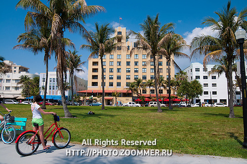 Girl on the bike on Ocean Drive, South Beach in Miami,