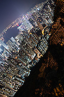 Hong Kong's Mid-Levels and Wan Chai districts (and beyond) lit up for the evening, seen from Victoria Peak