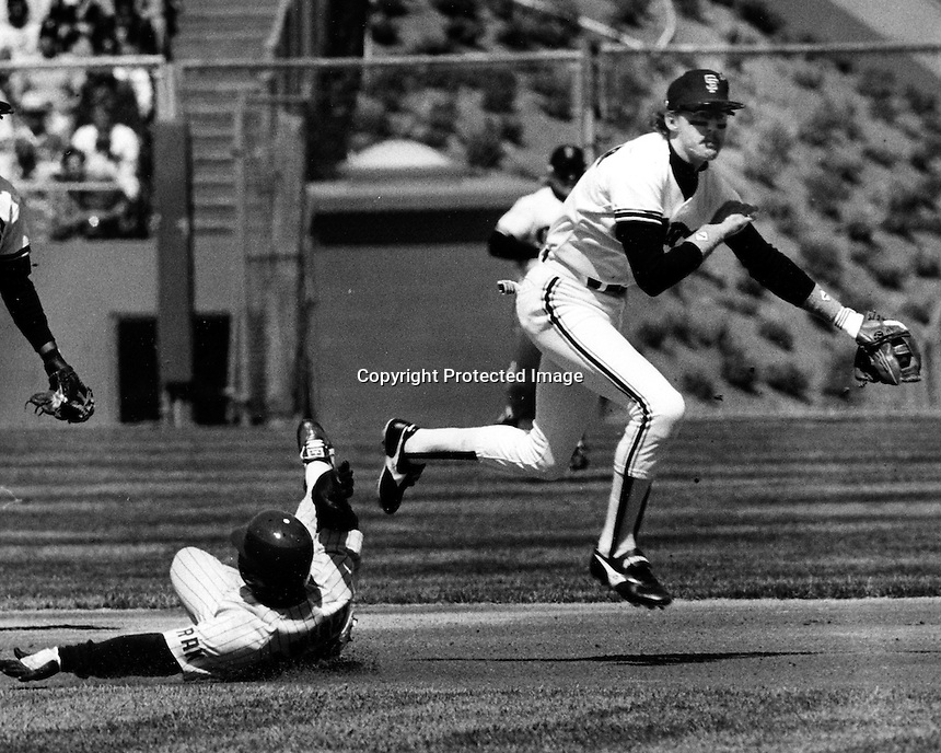 Giant shortstop Johnnie LeMaster completes doubleplay, Mario Ramerez out at 2nd. (1985 photo by Ron Riesterer)