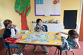 The youngest kids playing Monopoly, Summerhill School, Leiston, Suffolk. The school was founded by A.S.Neill in 1921 and is run on democratic lines with each person, adult or child, having an equal say.  You don't have to go to lessons if you don't want to but could play all day.  It gets above average GCSE exam results.