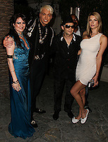 BEVERLY HILLS, CA, USA - MARCH 28: Vikki Lizzi, KUBA Ka, Corey Feldman, Catherine Annette at the Versace Unveiling Of The 1st Pop Recording Artist Superhero - KUBA Ka's Performance Outfits. Designed by the legendary fashion hosuse - Donatella Versace. For the Benefit of the Face Forward Foundation (Plastic Surgery for Destroyed Faces from Violence). Pop entertainer TV personality KUBA Ka, together with VERSACE, unveiled Kuba Ka's new Versace images, for the First Pop Artist/Superhero of the World. He has become the inspiration of Donatella's newest and wildest creations and will celebrate the launch of his new power house conglomerate - KUBA Ka Empire Inc. in collaboration with the sensational fashion house - VERSACE on Friday, his birthday at a red carpet media and celebrity event at the luxurious Peninsula Hotel in Beverly Hills held at the Peninsula Hotel on March 28, 2014 in Beverly Hills, California, United States. (Photo by Xavier Collin/Celebrity Monitor)