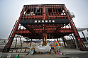 March 8, 2012, Minamisannriku-cho, Japan - The steel structure of the new disaster prevention office stands idle at Minamisannriku-cho, Miyagi Prefecture, some 365 km northeast of Tokyo, on Thursday, March 8, 2012. ..One year after the strongest earthquake ever to hit Japan, the economy is recovering and massive cleanup operations are in full swing throughout much of the countrys northeastern region. But once-pastoral landscapes that were piled with rubble and debris have become empty wastelands due mainly to bickering and disagreements between the central and local governments over rebuilding the devastated region. A year later, more than 260,000 people still live in temporary shelters. (Photo by Natsuki Sakai/AFLO) AYF -mis-.