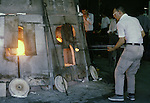 An artisan works near the factory's blast furnances at the Hokuyo Glass Manufacturing Company's  Blown Glass Factory in Aomori, Japan. Glass blowers at the factory churn out between 1,500 and 2,000 pieces of glass daily. (Jim Bryant Photo)......