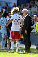 Red Bulls head coach Hans Backe talks with Stephen Keel (22) during a injury time out...Sporting Kansas City defeated New York Red Bulls 2-0 at LIVESTRONG Sporting Park, Kansas City, Kansas.