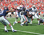 Ole Miss defensive end Jason Jones (38) tackles Auburn quarterback Jonathan Wallace (12) at Vaught-Hemingway Stadium in Oxford, Miss. on Saturday, October 13, 2012. (AP Photo/Oxford Eagle, Bruce Newman)..