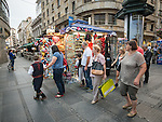 Walking along the streets by a kiosk in the pedestrian area of downtown Belgrade, Serbia
