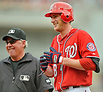 22 July 2012: Washington Nationals pitcher Ross Detwiler is all smiles as he stands on first with a base hit against the Atlanta Braves at Nationals Park in Washington, DC. The Nationals defeated the Braves 9-2 to split their 4-game weekend series. Mandatory Credit: Ed Wolfstein Photo