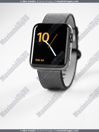 Apple Watch series 2 smartwatch with analog clock dial on display isolated on white background
