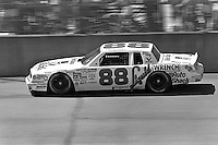 BROOKLYN, MI - AUGUST 11: Buddy Baker drives his Oldsmobile during the Champion Spark Plug 400 NASCAR Winston Cup race at the Michigan International Speedway near Brooklyn, Michigan, on August 11, 1985.