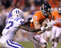 CHARLOTTESVILLE, VA- NOVEMBER 12: Tight end Paul Freedman #88 of the Virginia Cavaliers makes a catch in front of cornerback Johnny Williams #37 of the Duke Blue Devils during the game against the Duke Blue Devils on November 12, 2011 at Scott Stadium in Charlottesville, Virginia. Virginia defeated Duke 31-21. (Photo by Andrew Shurtleff/Getty Images) *** Local Caption *** Paul Freedman;Johnny Williams