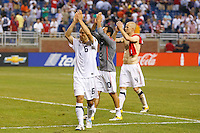 7 June 2011: USA Men's National Team defender Steve Cherundolo (6), midfielder Landon Donovan (10) and midfielder Michael Bradley (4) salutes the fans after the CONCACAF soccer match between USA and Canada at Ford Field Detroit, Michigan. USA won 2-0.
