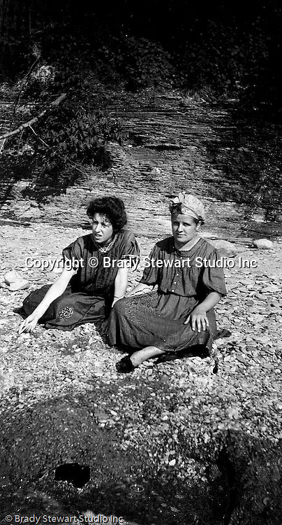 North East PA: Helen Stewart and Aunt Margaret Gray relaxing on the rocks on the Lake Erie shoreline.  During the early 1900s, the Stewart family vacationed on Lake Erie near North East Pennsylvania. Since hotels and motels were non-existent, camping was the only viable option for a large number of vacationers