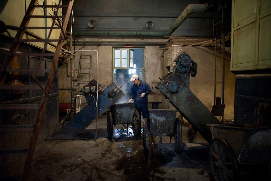 A worker shovels coal in to a large furnace that heats an entire city block in Linfen, known as one of China's most polluted cities.