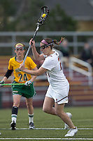 Boston College midfielder Meghan Conley (24) shoots the ball. Boston College defeated University of Vermont, 15-9, at Newton Campus Field, April 4, 2012.