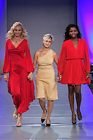 Fashion designer Tammy Duffy walks the runway with models at the close of her Tammy Duffy fashion show, during Couture Fashion Week Spring 2012.