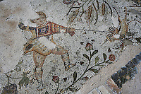 Detail of a mosaic depicting a boy playing with a bird in the Villa of the Aviary, Carthage, Tunisia, pictured on January 27, 2008, in the afternoon. Carthage was founded in 814 BC by the Phoenicians who fought three Punic Wars against the Romans over this immensely important Mediterranean harbour. The Romans finally conquered the city in 146 BC. Subsequently it was conquered by the Vandals and the Byzantine Empire. Today it is a UNESCO World Heritage. The Roman Villa of the Aviary, with its octagonal garden set in a peristyle courtyard, is known for its fine mosaics depicting birds. Picture by Manuel Cohen.