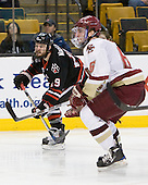 Wade MacLeod (Northeastern - 19), Patrick Wey (BC - 6) - The Boston College Eagles defeated the Northeastern University Huskies 5-4 in their Hockey East Semi-Final on Friday, March 18, 2011, at TD Garden in Boston, Massachusetts.