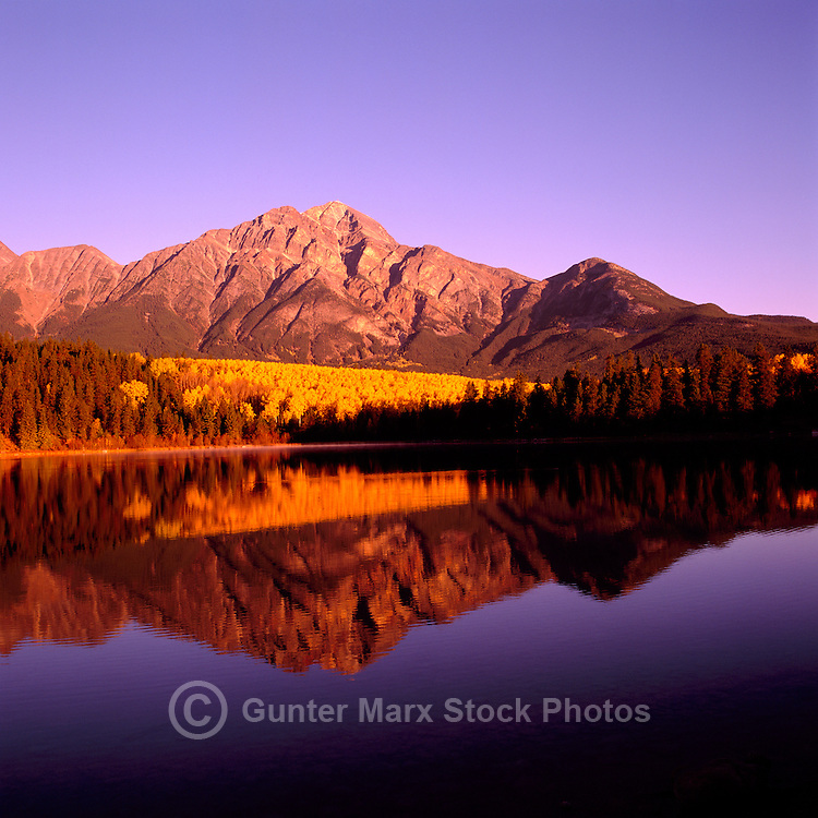 Pyramid Mountain (Elev 2,766 m / 9,075 ft) reflecting in Pyramid Lake near Jasper, in Jasper National Park, in the Canadian Rockies, Alberta, Canada, in Autumn