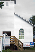 A man stands outside of a Church in Yesteryear Village at the N.C. State Fair on Sunday October 14th, 2012.
