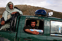 Police pass us with suspicious looks on their faces. out here the police are in constant battle with the Taliban and are always on alert for potential attacks.