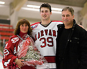 Pier-Olivier Michaud (Harvard - 39) with his mother and father Bertrand Michaud. - The Harvard University Crimson defeated the St. Lawrence University Saints 4-3 on senior night Saturday, February 26, 2011, at Bright Hockey Center in Cambridge, Massachusetts.