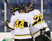 Andrew Yarber (WIT - 7), Lawton McCracken (WIT - 44) and Mike Domsodi (WIT - 28) celebrate Yarber's goal. - The Wentworth Institute of Technology Leopards defeated the Salve Regina University Seahawks 2-1 on Tuesday, November 12, 2013, at Tsongas Arena in Lowell, Massachusetts.