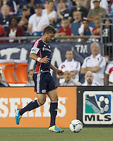New England Revolution defender Chris Tierney (8) brings the ball forward.  In a Major League Soccer (MLS) match, Toronto FC (white/red) defeated the New England Revolution (blue), 1-0, at Gillette Stadium on August 4, 2013.