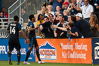 Sheanon Williams (25) of the Philadelphia Union celebrates scoring with fans. The Philadelphia Union defeated the Columbus Crew 3-0 during a Major League Soccer (MLS) match at PPL Park in Chester, PA, on June 5, 2013.