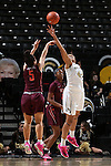 25 February 2016: Wake Forest's Kandice Ball (42) blocks a shot by Virginia Tech's Vanessa Panousis (AUS) (5). The Wake Forest University Demon Deacons hosted the Virginia Tech Hokies at Lawrence Joel Veterans Memorial Coliseum in Winston-Salem, North Carolina in a 2015-16 NCAA Division I Women's Basketball game. Virginia Tech won the game 54-48.