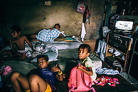 Children lying on matresses placed on the floor of a room in an overcrowded house. Often several families live in one home and overpopulated Ebeye is informally known as the 'slum of the Pacific'. It people suffer numerous diseases and the mortality rate is one of the highest in the Republic of the Marshall Islands.