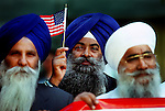 Gurbex Singh, of the California Sikh Temple in Californa, shows his love of America during the California Day of Rememberance at the state Capitol, Tuesday Oct. 9, 2001. (AP PHOTO/Brian Baer)