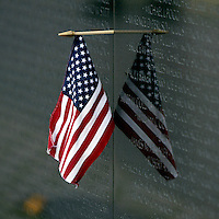 Jun 14, 2004; Washington DC, Washington, USA;  Flag Day. American Flag hangs at the Vietnam Veterans War Memorial inside Constituion Gardens.  United States statue landmark.