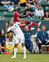 CARSON, CA – July 9, 2011: LA Galaxy Juninho (19) and Chicago Fire forward Dominic Oduro (8) during the match between LA Galaxy and Chicago Fire at the Home Depot Center in Carson, California. Final score LA Galaxy 2, Chicago Fire FC 1.