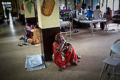 A young woman is seen sitting on the floor of the pediatrics section of the Maharani Laxmibai Medical College in Jhansi, Uttar Pradesh, India. The Indian government spends $1.4 billion a year - on programs that include weighing newborn babies, counseling mothers on healthy eating and supplementing meals, but none of this is yeilding results. According to UNICEF, some 48% of Indian children, or 61 million kids, remain malnourished, the clinical condition of being so undernourished that their physical and mental growth are stunted. Photo: Sanjit Das/Panos for The Wall Street Journal.Slug: IMALNUT