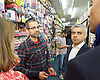 Sadiq Khan <br /> Labour mayor of London candidate and Chuka  Umunna MP for Brixton &amp; Streatham walk around Brixton canvassing locals to support Labour in the forthcoming 5th May election.<br /> <br /> Sadiq Khan and <br /> Chaka Umunna <br /> talking to the owner of Beauty World Cosmetics 11 Electric Avenue Brixton <br /> <br /> Photograph by Elliott Franks <br /> Image licensed to Elliott Franks Photography Services