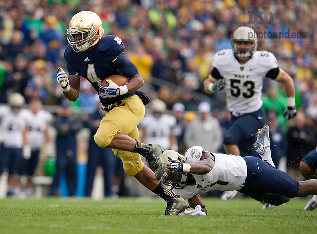 Nov. 2, 2013; Running back George Atkinson III (4) breaks free for a touchdown in the first quarter against Navy.<br /> <br /> Photo by Matt Cashore